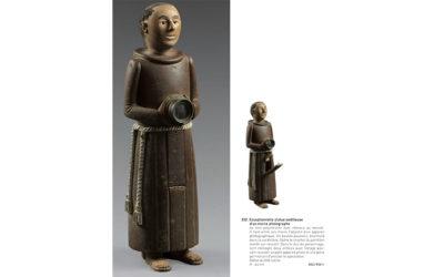 Statuette licencieuse d'un moine photographe